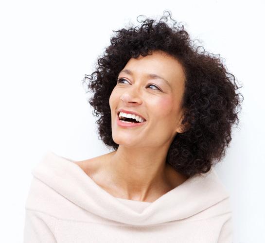 woman laughing looking away